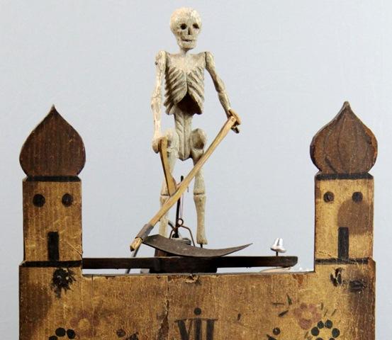 Hodiny s pohyblivou smrtkouM
